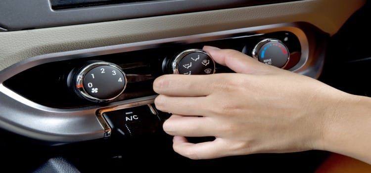 why is your car's air conditioner blowing hot air